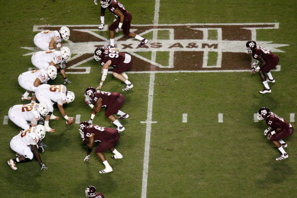 The Texas Longhorns offense forms over the Big 12 XII logo during the first half of the Texas A&M Aggies vs University of Texas Longhorns rivalry NCAA football game at Kyle Field on Thanksgiving Day, Thursday, November 24, 2011 in College Station, Texas. (Patrick T. Fallon/The Dallas Morning News)