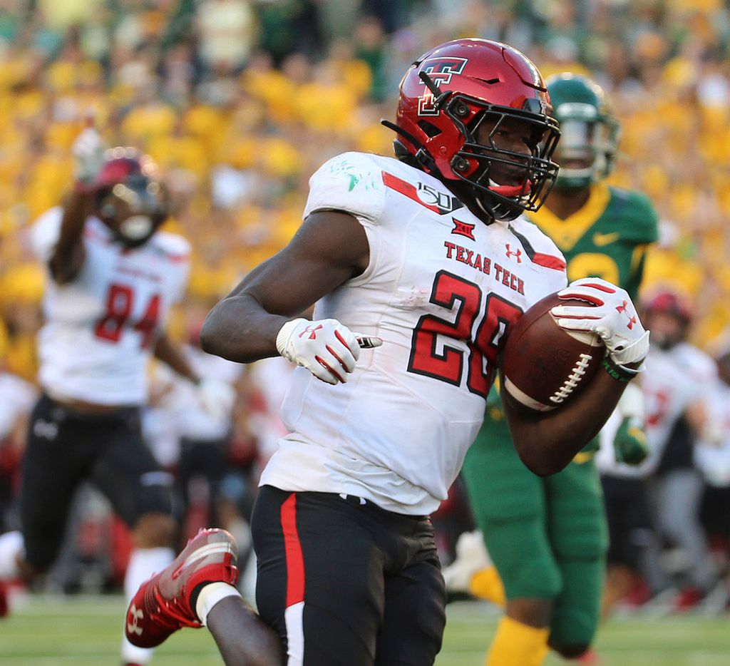Texas Tech running back SaRodorick Thompson (28) scores a touchdown against Baylor during the second half of a NCAA college football game in Waco, Tex., Saturday, Oct. 12, 2019.(AP Photo/Jerry Larson)