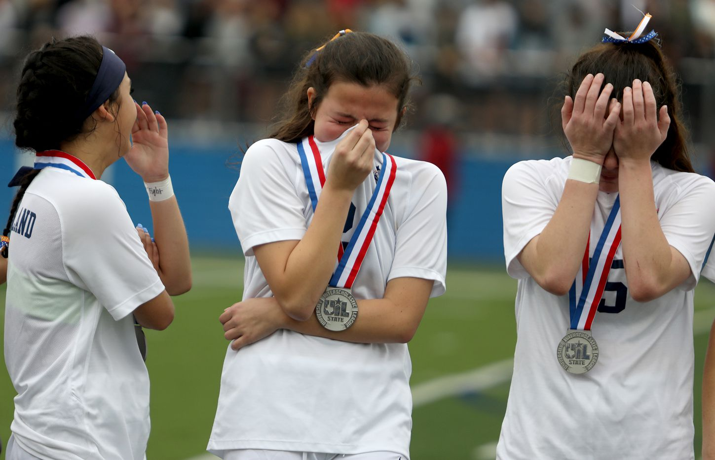 Wakeland's Natalie Cox (from left), Rachel Perry, and Ally Perry react after their UIL 5A girls State championship soccer game against Dripping Springs at Birkelbach Field on April 16, 2021 in Georgetown, Texas. Dripping Springs won 2-1.  (Thao Nguyen/Special Contributor)