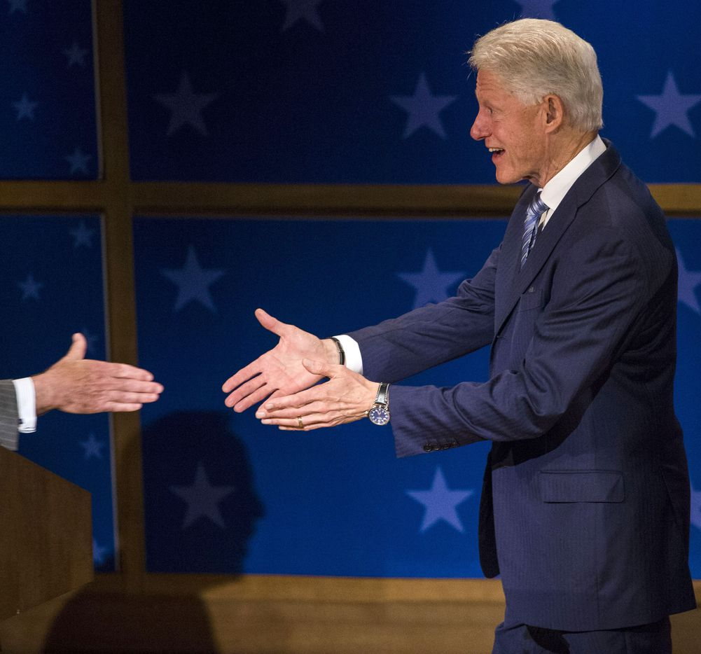 Former President Bill Clinton reaches for a handshake during the Presidential Leadership Scholars Graduation at the George W. Bush Presidential Center in Dallas, Texas, Thursday, July 13, 2017.