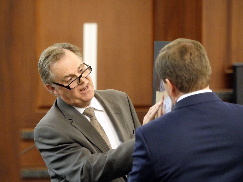 Dr. Jeffrey Barnard (left) described gunshot entry wounds on the body of Kaufman County prosecutor Mark Hasse to prosecutor Toby Shook at the murder trial of Eric Williams in December 2014. Williams was convicted and is now on death row.