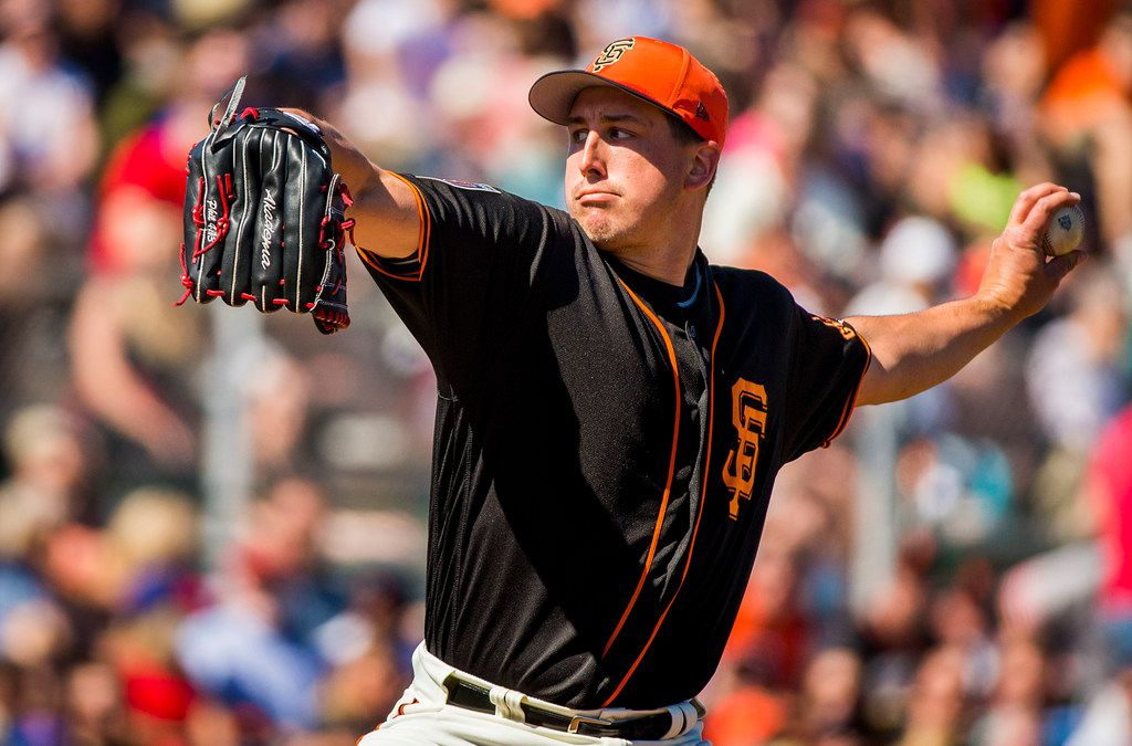 San Francisco Giants pitcher Derek Holland pitches during the third inning of a spring training baseball game against the Texas Rangers on Saturday, March 3, 2018, in Scottsdale, Ariz. (Smiley N. Pool/The Dallas Morning News)