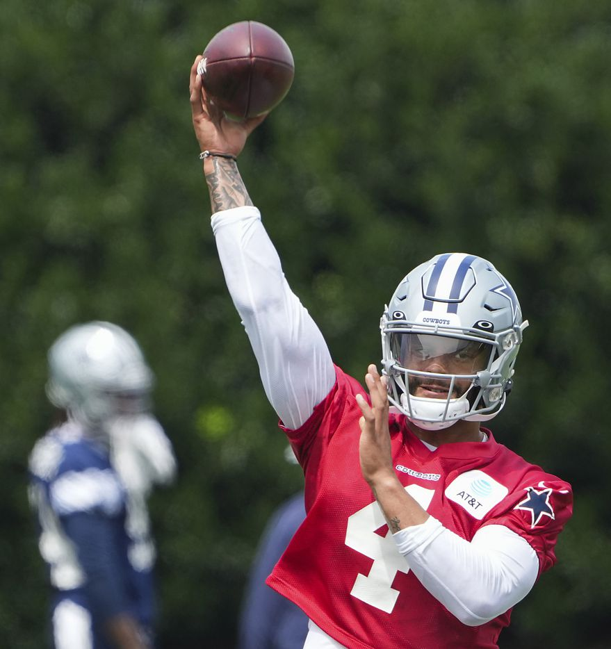 Dallas Cowboys quarterback Dak Prescott (4) throws a pass during a minicamp practice at The Star on Tuesday, June 8, 2021, in Frisco. (Smiley N. Pool/The Dallas Morning News)
