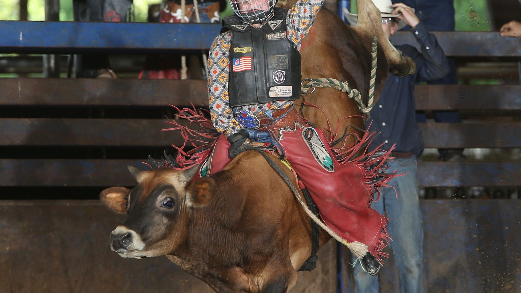 Hunter Durham, 9, rides a miniature bull in preparation of the International Mini Bull Riders Association World Finals in Mesquite from Dec. 7-12, 2020.