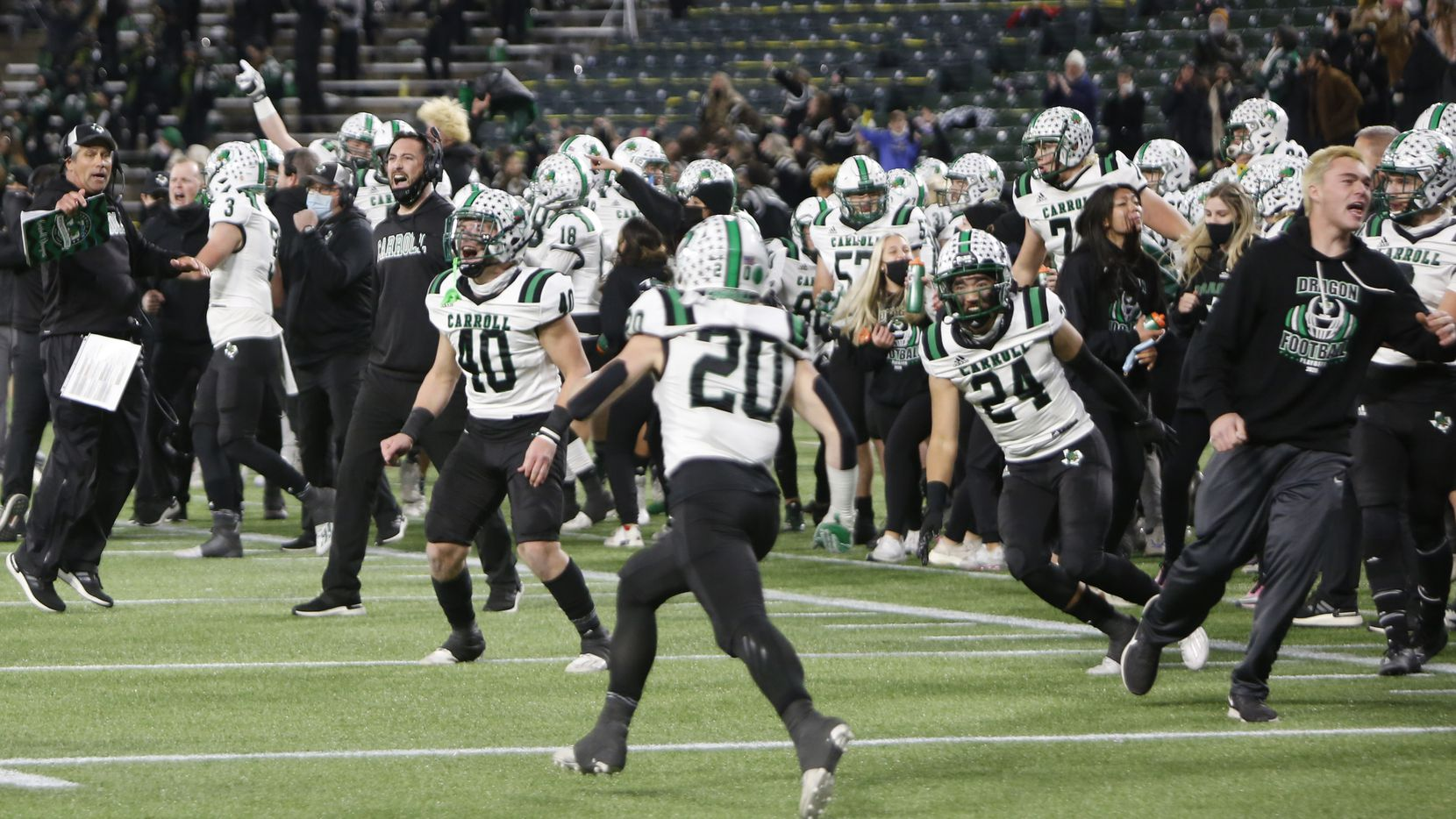 The Southlake bench erupts at a change of possession during the final seconds of the fourth quarter of their game against Arlington Martin. The Dragons defeated Martin 30-26 to advance. The two teams played their Class 6A Division l Region l semifinal football playoff game held at Globe Life Park in Arlington on December 24, 2020. (Steve Hamm/ Special Contributor)
