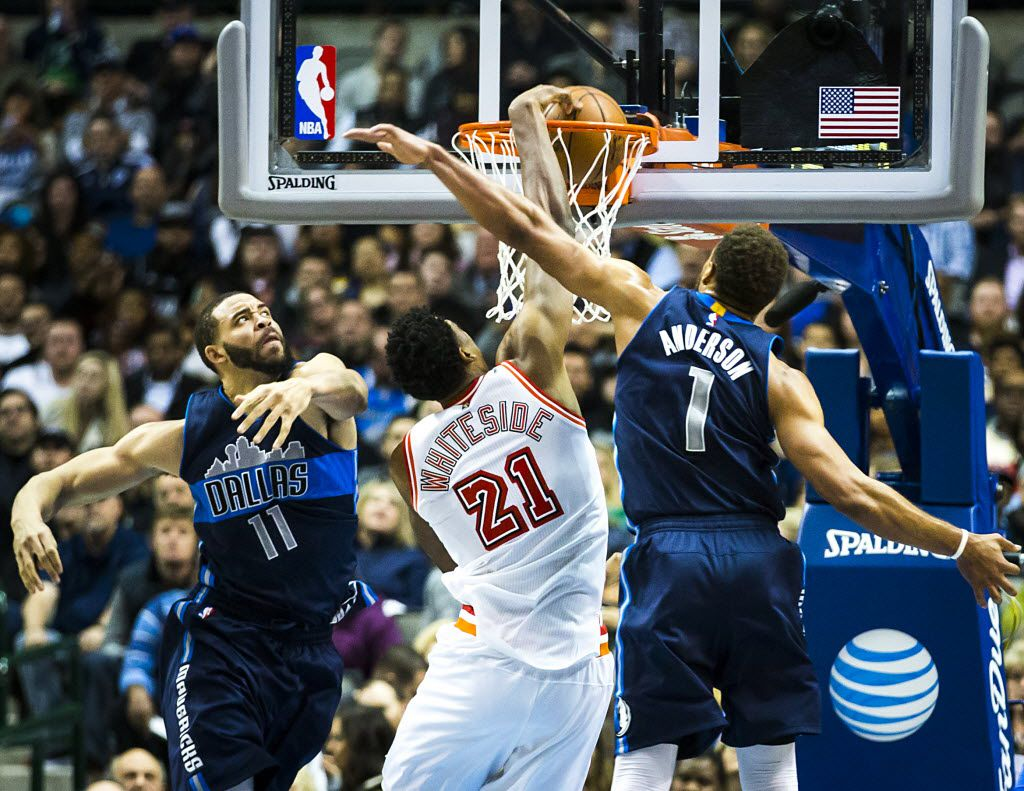 Miami Heat center Hassan Whiteside (21) dunks the ball past Dallas Mavericks center JaVale McGee (11) and Dallas Mavericks guard Justin Anderson (1) during the first half of an NBA basketball game at American Airlines Center on Wednesday, Feb. 3, 2016, in Dallas. (Smiley N. Pool/The Dallas Morning News)