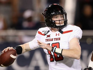 TUCSON, ARIZONA - SEPTEMBER 14:  Quarterback Alan Bowman #10 of the Texas Tech Red Raiders looks t0 pass during the second half of the NCAAF game against the Arizona Wildcats at Arizona Stadium on September 14, 2019 in Tucson, Arizona.