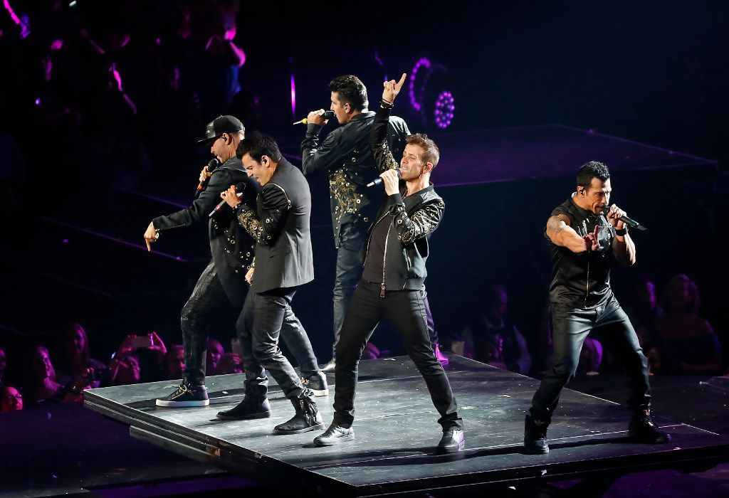 Members of New Kids On The Block Donnie Wahlberg, Joey McIntyre, Danny Wood, Jordan Knight and Jonathan Knight perform during the Total Package Tour at American Airlines Center on Tuesday.