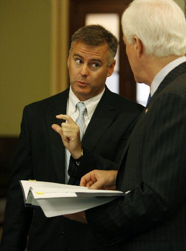 Reed O'Connor, shown here when he was the newest federal judge in North Texas, chats with U. S. Senator John Cornyn of Texas.