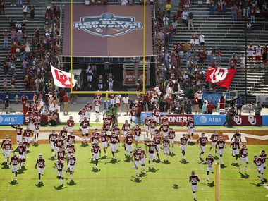 The Oklahoma Sooners football team takes the field to face the Texas Longhorns in the Red River Rivalry at the Cotton Bowl in Dallas, Saturday, October 10, 2020.
