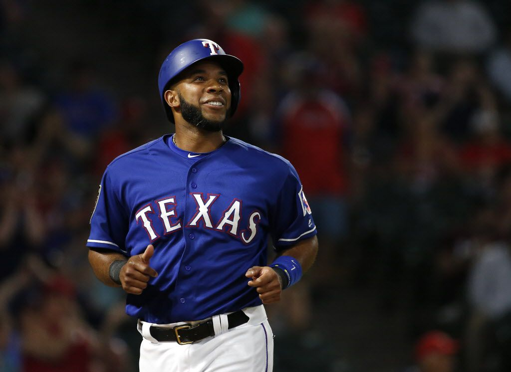 FILE — Texas Rangers shortstop Elvis Andrus smiles after scoring a run on the double by Shin-Soo Choo during the third inning against Cincinnati Reds at Globe Life Park in Arlington, Texas, Monday, March 26, 2018.