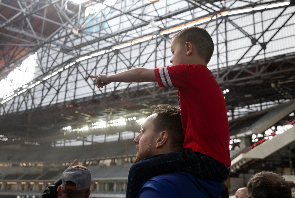 Brett Albers from Fort Worth holds his son Adrian Shahan, 5, as they check out the Globe Life Field during the Rangers' Peek at the Park fanfest on Jan. 25, 2020 in Arlington. (Juan Figueroa/ The Dallas Morning News)