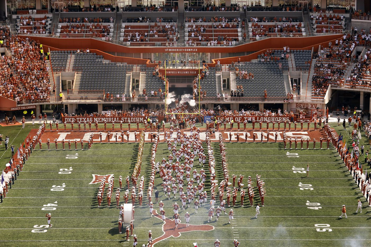 The Texas Longhorns football team sprints down the middle of the field as they introduced to the DKR-Texas Memorial Stadium crowd in Austin, Saturday, September 4, 2021. The Longhorns were facing the Louisiana-Lafayette Ragin Cajuns in the season opener. (Tom Fox/The Dallas Morning News)