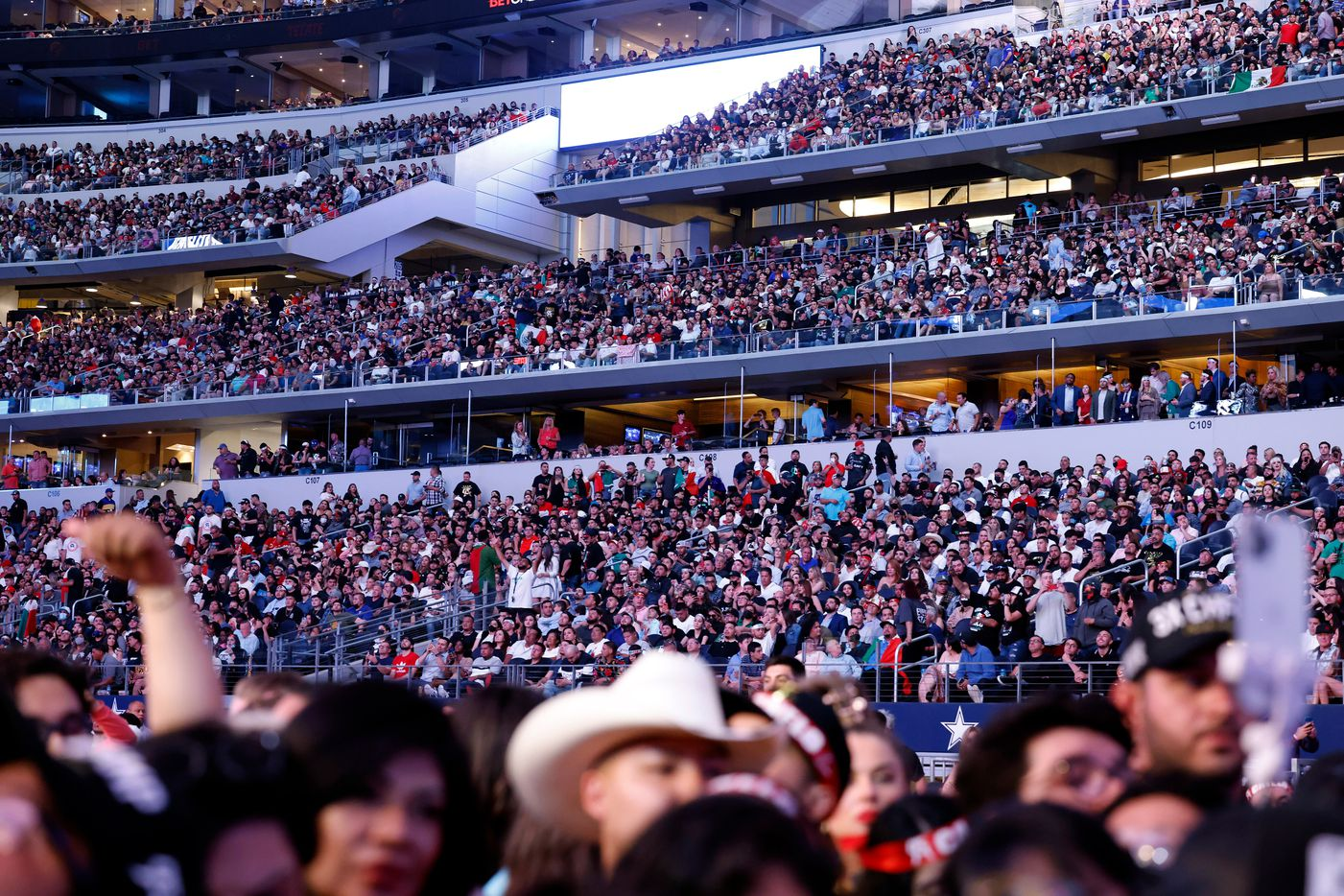 Over 70,000 people, the largest crowd to see a sporting event during the COVID-19 pandemic, filled AT&T stadium to see Mexican boxer Canelo Alvarez defeat British boxer Billy Joe Saunders in their super middleweight title fight at AT&T Stadium in Arlington, Saturday, May 8, 2021. Saunders couldn't go on because of an eye injury. (Tom Fox/The Dallas Morning News)