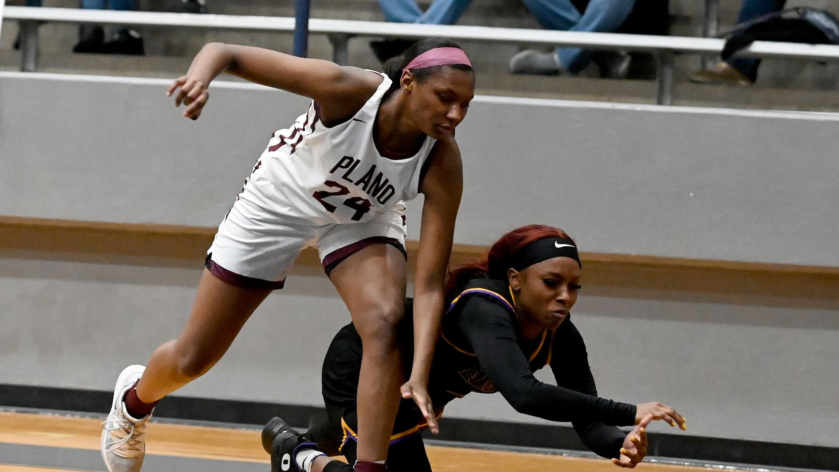 Richardson's Callie Cooper goes after a loose ball with Plano's Amaya Brannon (24) in the second half of a Class 6A girls high school playoff basketball game between Plano vs. Richardson, Monday, Feb. 22, 2020, in Carrollton, Texas.