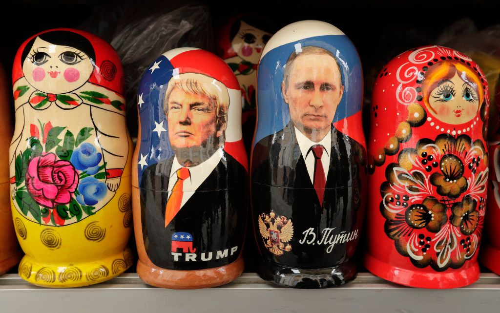 In this Monday, Feb. 20, 2017 traditional Russian wooden dolls called Matryoshka depicting US President Donald Trump, centre left and Russian President Vladimir Putin are displayed for sale at a souvenir street shop in St.Petersburg, Russia.?The Kremlin refrained from comment Tuesday, Feb. 21, 2017 on the appointment of the new U.S. national security adviser Army Lt. Gen. H.R. McMaster, but one lawmaker said he was likely to take a hawkish stance toward Russia. (AP Photo/Dmitri Lovetsky)