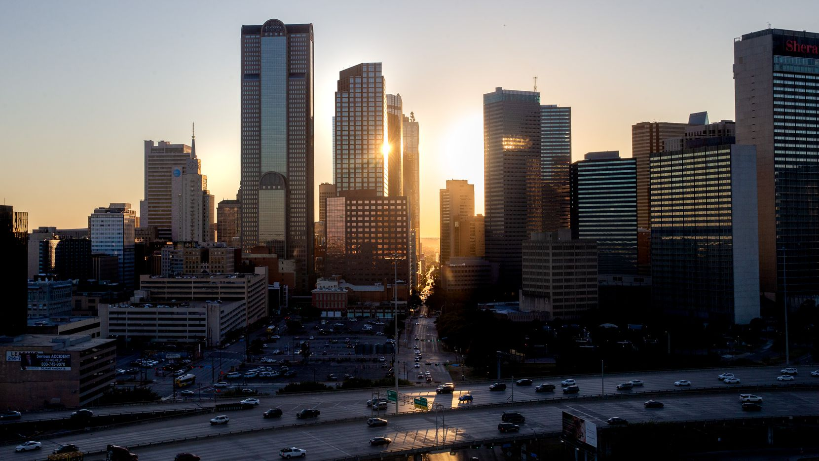 The sun sets behind the downtown Dallas skyline on Tuesday, Oct. 9, 2019.  (Lynda M. Gonzalez/The Dallas Morning News)
