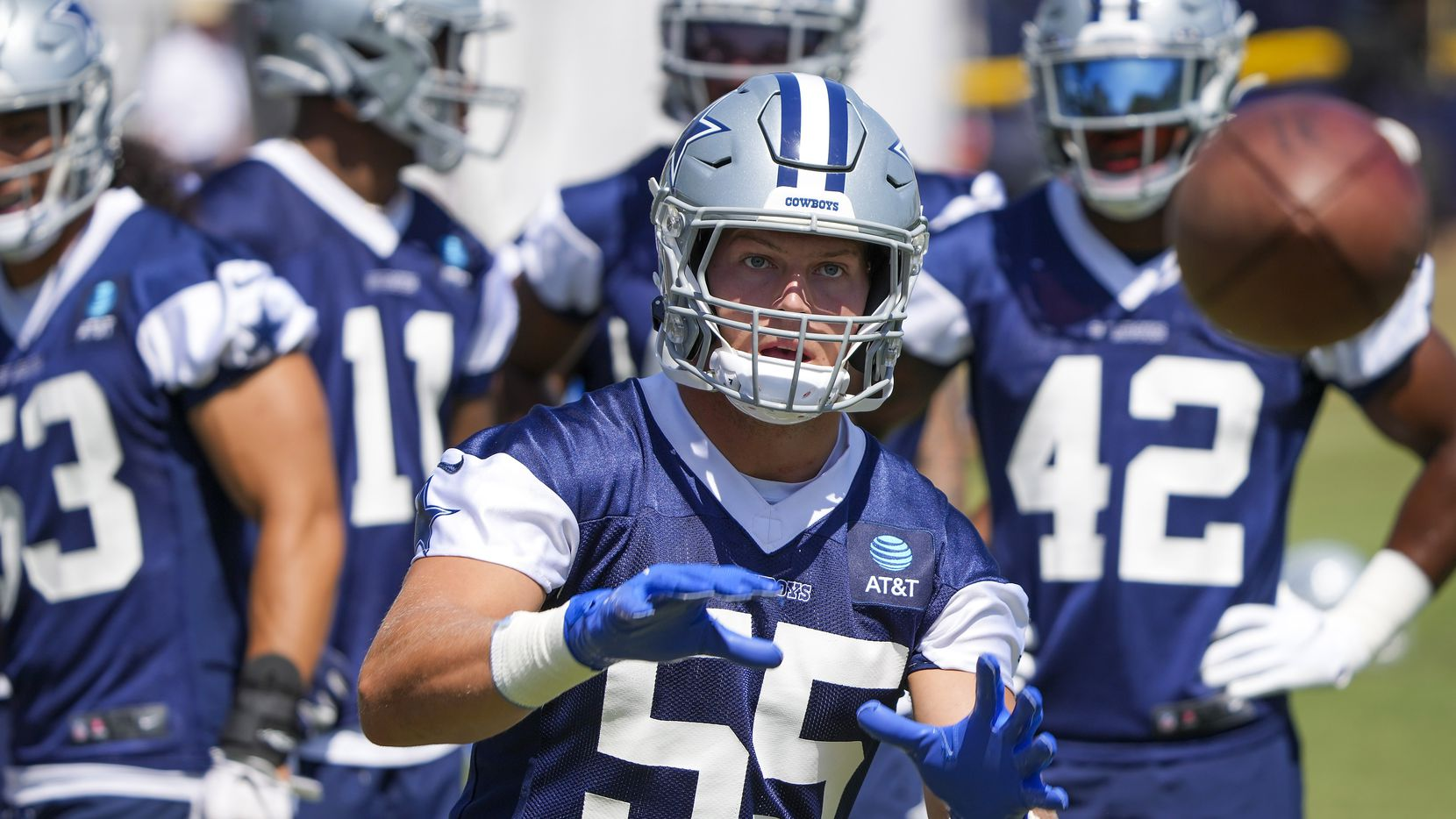 Dallas Cowboys linebacker Leighton Vander Esch (55) catches a ball during the first practice of the team's training camp on Thursday, July 22, 2021, in Oxnard, Calif.