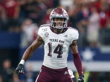 Texas A&M Aggies defensive back Keldrick Carper (14) celebrates after stopping Arkansas Razorbacks on a fourth down in the last seconds of the second half of a NCAA football game between Texas A&M Aggies and Arkansas Razorbacks on Saturday, September 28, 2019 at AT&T Stadium in Arlington, Texas.