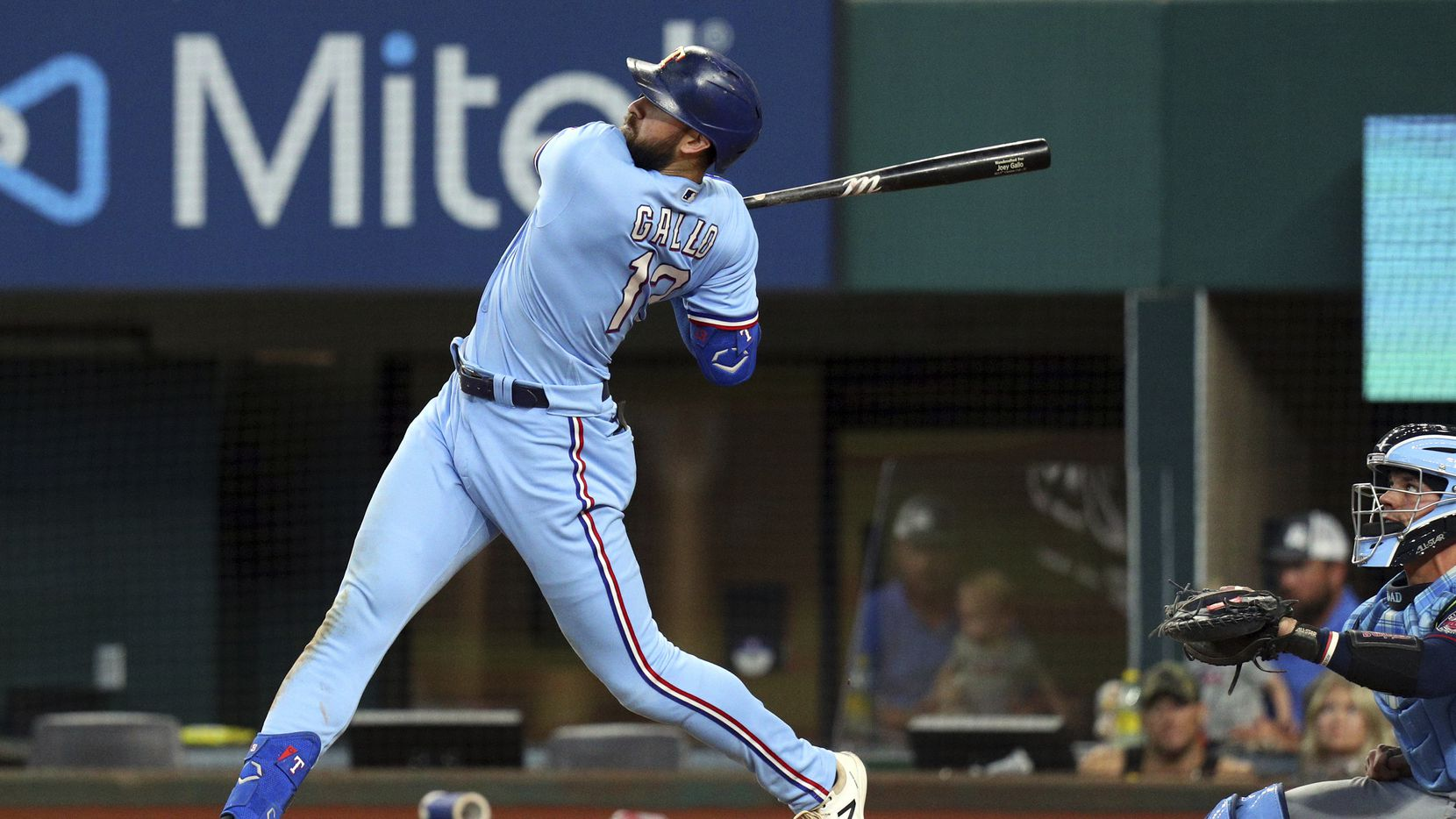 Texas Rangers Joey Gallo (13) follows through on a solo home run in the sixth inning against the Minnesota Twins in a baseball game Sunday, June 20, 2021, in Arlington, Texas.