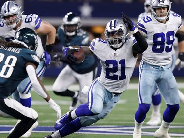Dallas Cowboys running back Ezekiel Elliott (21) makes a cut to avoid the tackle by Philadelphia Eagles defensive back Anthony Harris (28) during the second quarter at AT&T Stadium in Arlington, Monday, September 27, 2021.