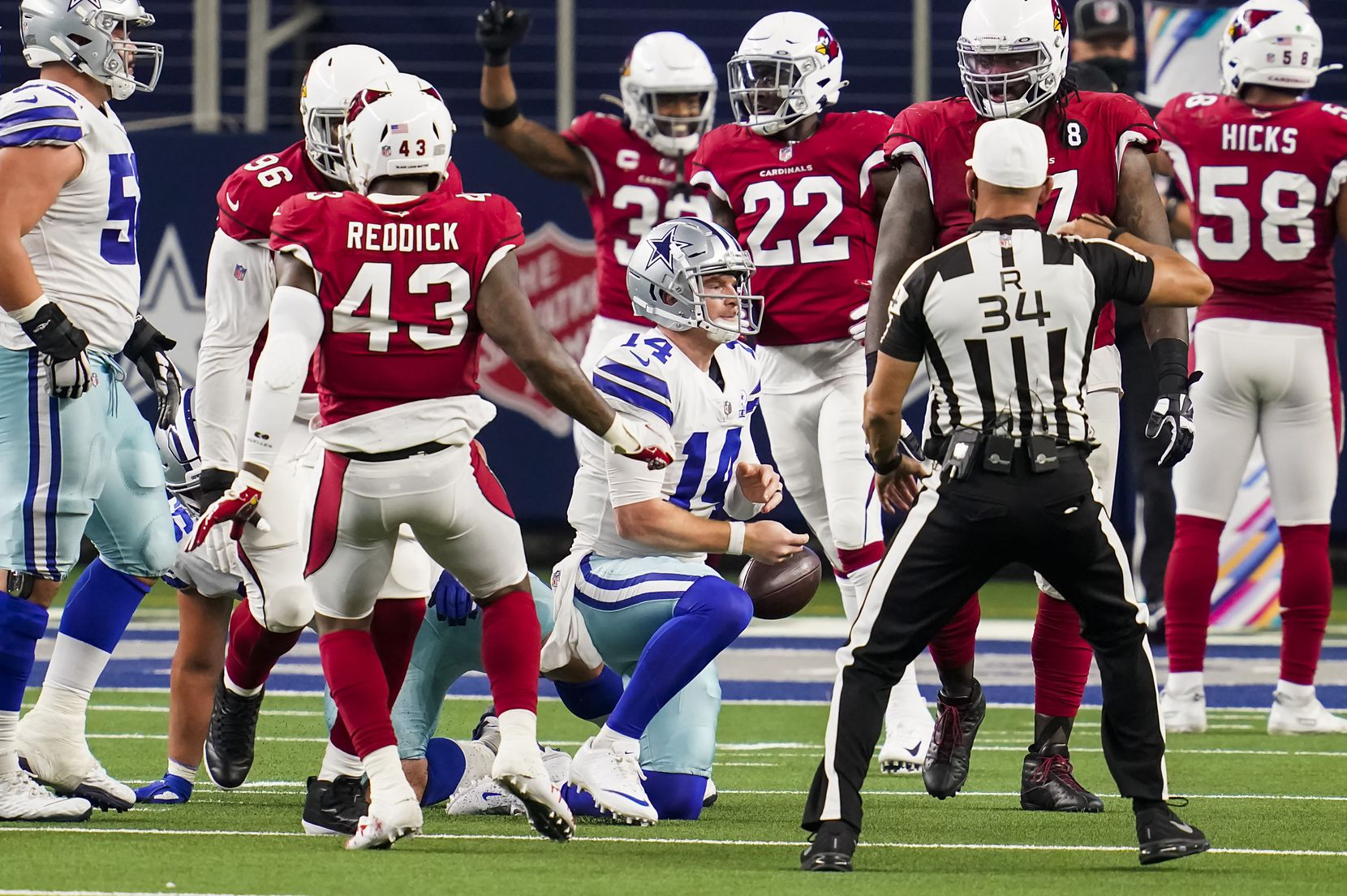 Dallas Cowboys quarterback Andy Dalton (14) tosses the ball away after being sacked by Arizona Cardinals outside linebacker Haason Reddick (43) during the second quarter of an NFL football game at AT&T Stadium on Monday, Oct. 19, 2020, in Arlington. (Smiley N. Pool/The Dallas Morning News)