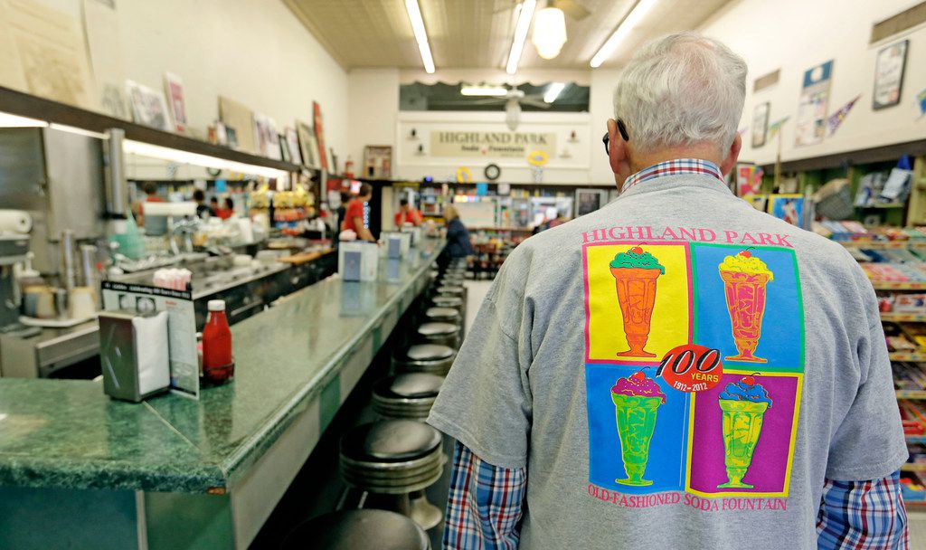 Owner Sonny Williams in a colorful T-shirt as he worked at the Highland Park Soda Fountain on Knox Street in Dallas in 2018.