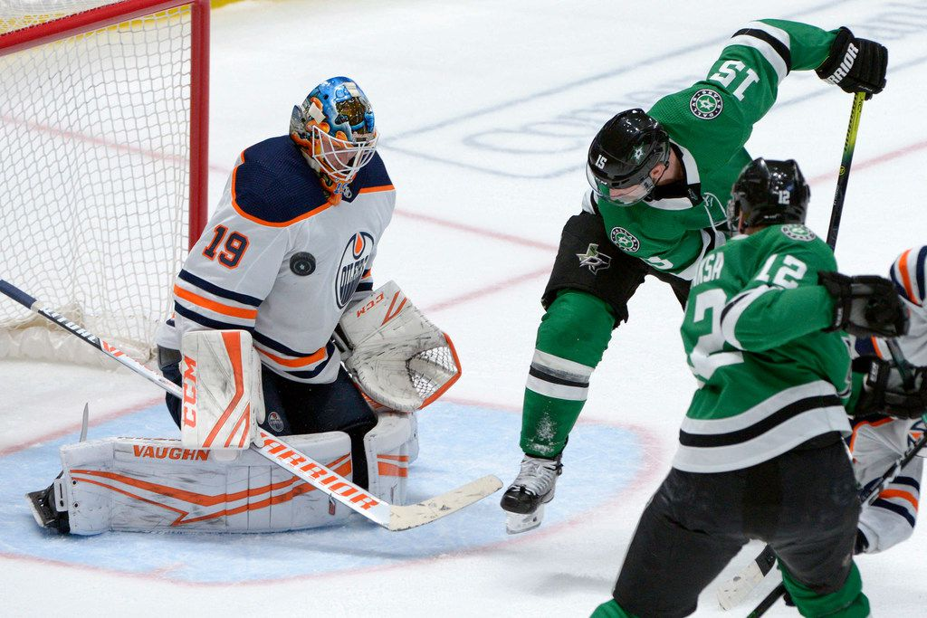 Edmonton Oilers goaltender Mikko Koskinen (19) makes the save on a shot by Dallas Stars left wing Blake Comeau (15) during the third period of an NHL hockey game in Dallas, Tuesday, March 3, 2020. The Oilers won 2-1 in overtime. (AP Photo/Matt Strasen)