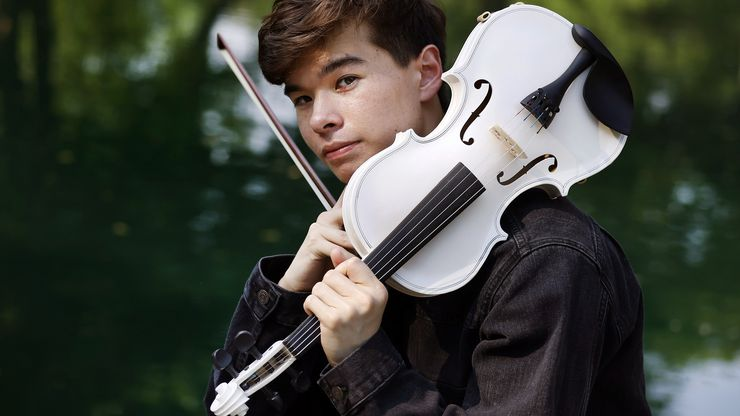 """Alan Milan, who graduated from Northwestern University last year, started playing the violin at age 7. His most-viewed video, a cover of """"lovely"""" by Billie Eilish and Khalid, has more than 13 million views."""