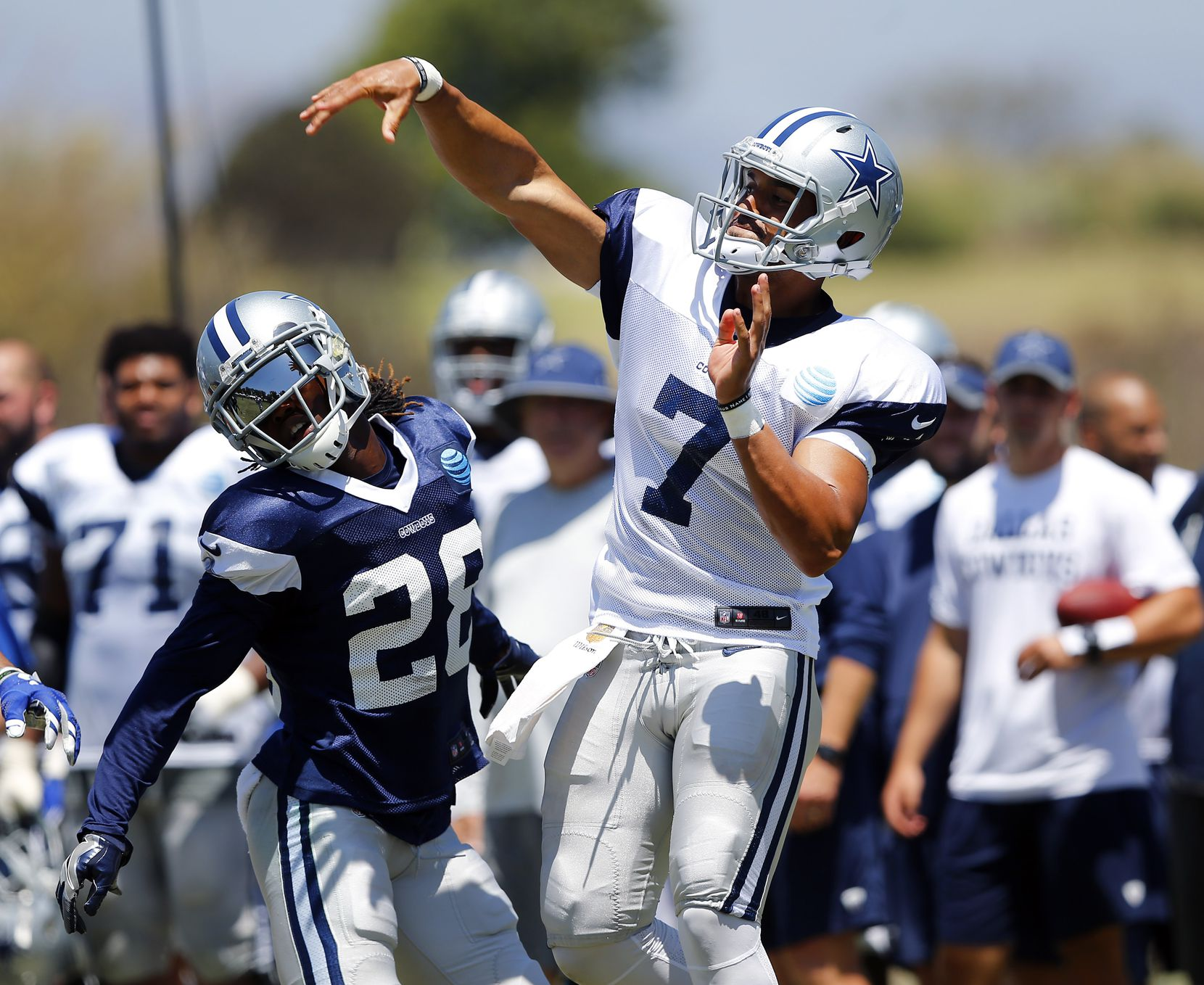 Dallas Cowboys quarterback Jameill Showers (7) releases a pass as defensive back Dax Swanson (28) pulls up on the pass rush during morning practice at training camp in Oxnard, California, Thursday, August 11, 2016. (Tom Fox/The Dallas Morning News)