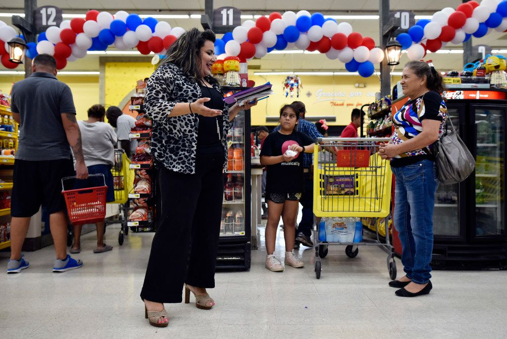 Poet and actress Priscilla Rice, 43, of Dallas reads her poetry to families waiting to pay for groceries inside El Rancho supermarket in Pleasant Grove on Aug. 26, 2017.