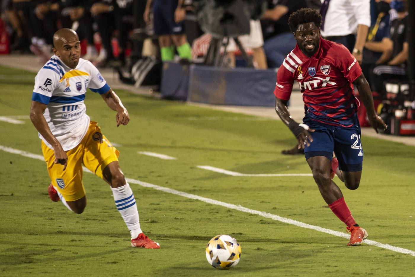 From left, San Jose midfielder Judson (93) and FC Dallas midfielder Ema Twumasi (22) race after the ball down the field during FC DallasÕ home game against the San Jose Earthquakes at Toyota Stadium in Frisco, Texas on Saturday, September 11, 2021. (Emil Lippe/Special Contributor)