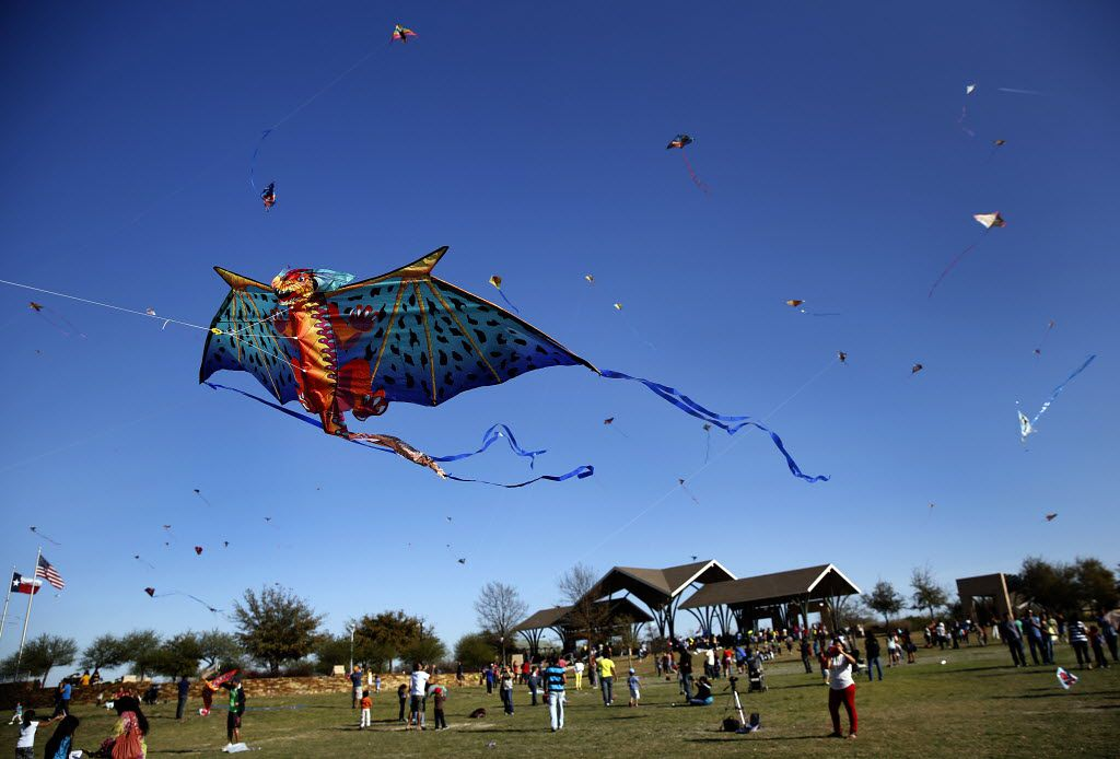 A dragon kite takes flight with several others at the 11th Annual Kite Flying Festival sponsored by Texas Instruments and held at Frisco Commons Park in Frisco, Saturday, March 29, 2014.