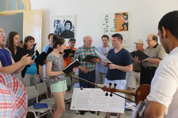 Credo Choir conductor Jonathan Palant (front right, in black T-shirt) leads the group at in a musical exchange.