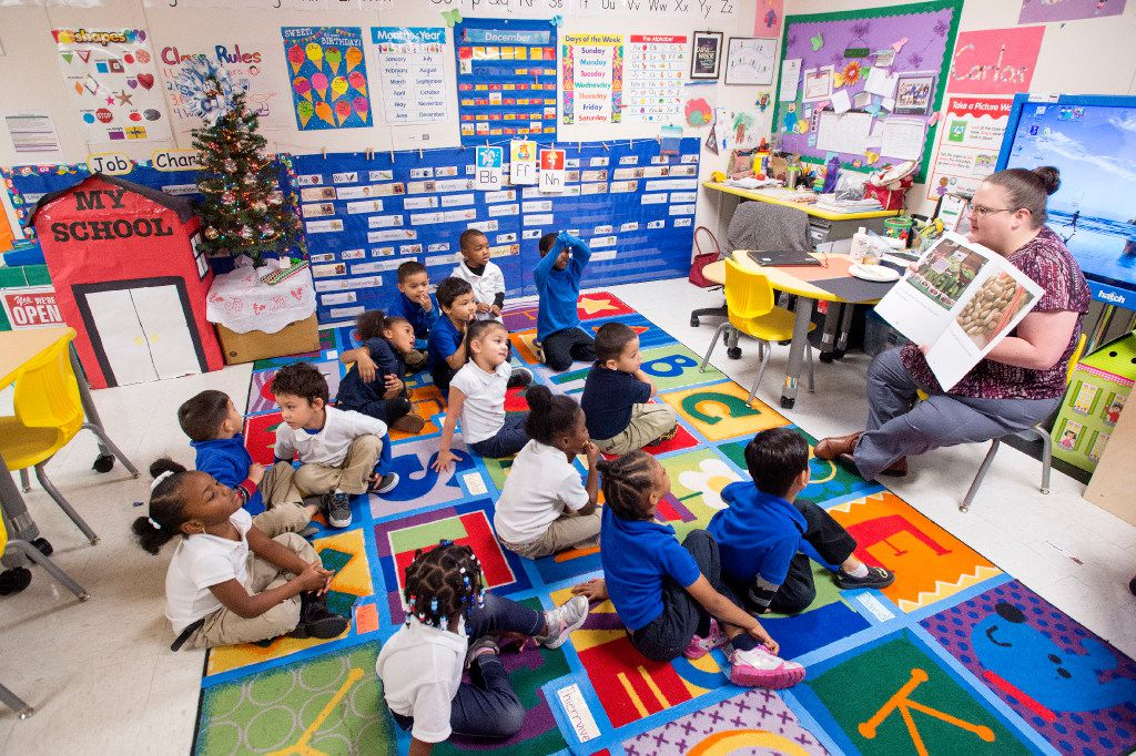 Preschool teacher Dana Wilson teaches a lesson about food and nutrition on Friday, December 9, 2016 at Wilmer Early Childhood Center in Wilmer, Texas. (Jeffrey McWhorter/Special Contributor)