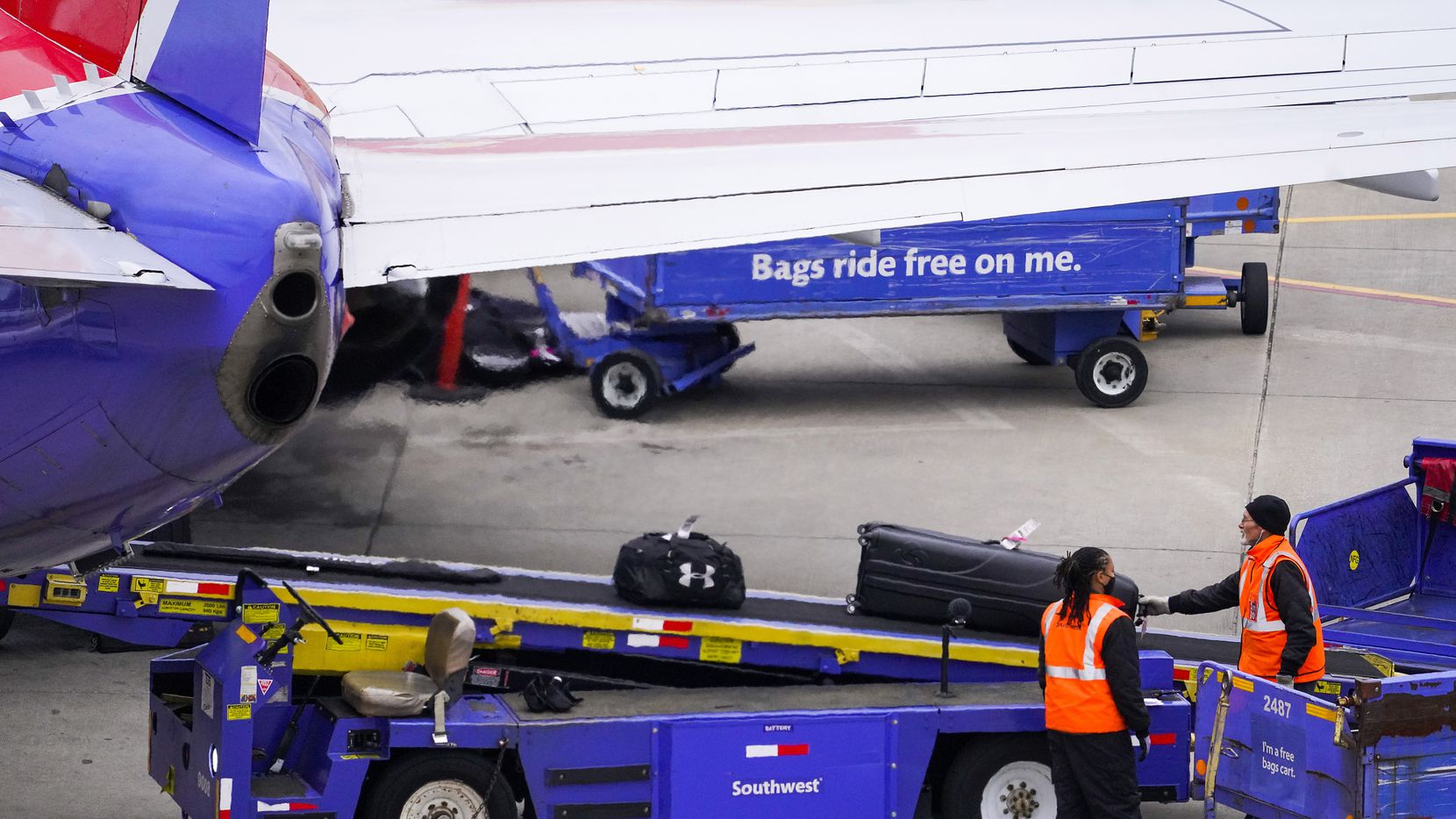 Baggage handlers unloaded a Southwest Airlines flight at Dallas Love Field in January.