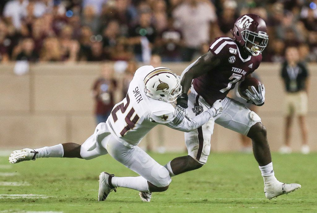 Texas State Bobcats safety Jalen Smith (24) works to bring down Texas A&M Aggies running back Jashaun Corbin (7) prior to a college football game between Texas A&M and Texas State on Thursday, Aug. 29, 2019 at Kyle Field in College Station, Texas. (Ryan Michalesko/The Dallas Morning News)