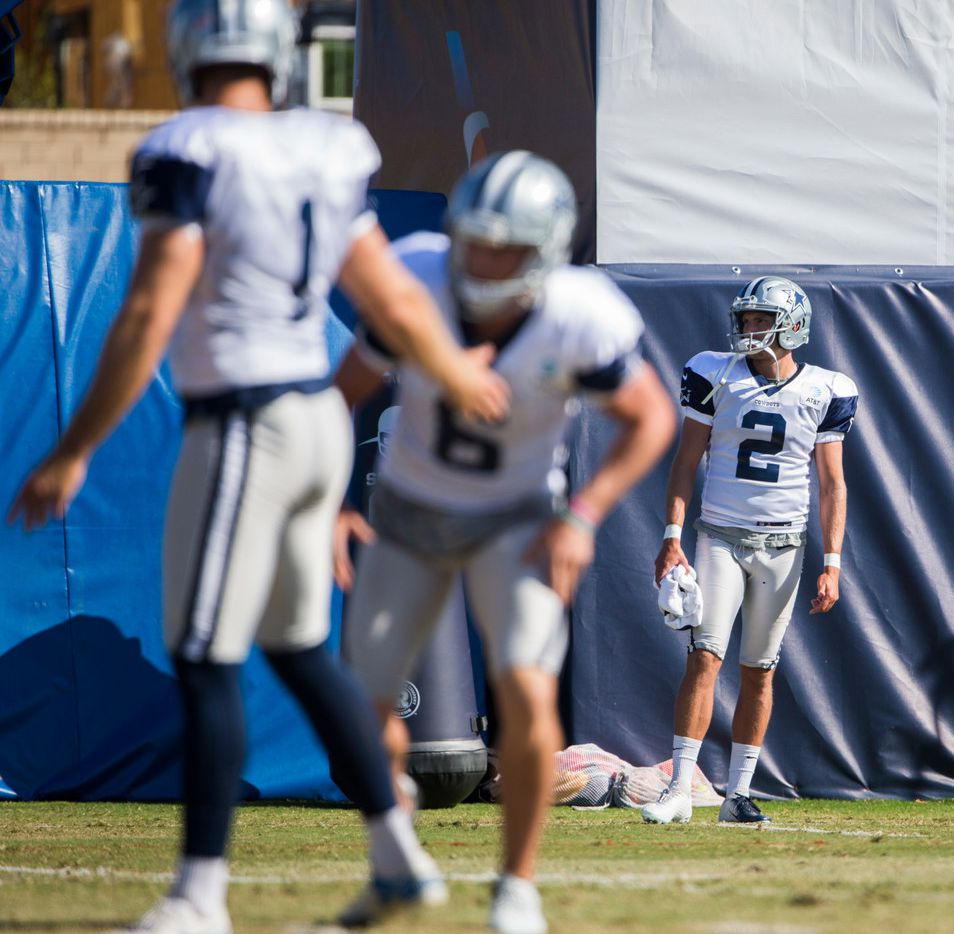Dallas Cowboys kicker Brett Maher (2) watches as punter Kasey Redfern (1) attempts a field goal with the help of punter Chris Jones (6) during an afternoon practice at training camp in Oxnard, California on Wednesday, August 7, 2019. (Ashley Landis/The Dallas Morning News)