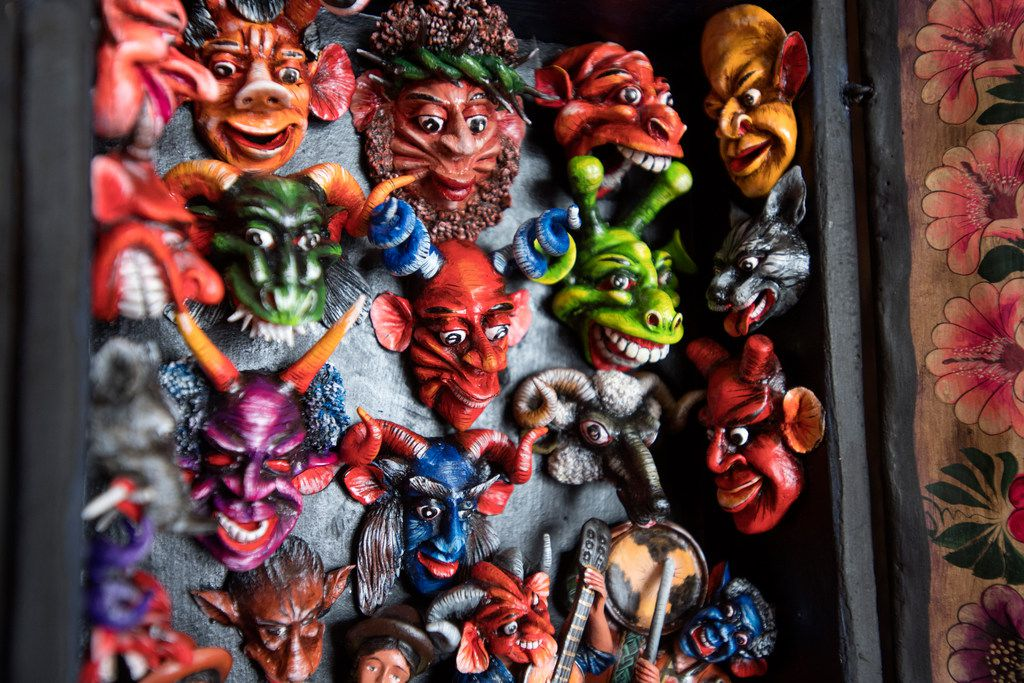 """Figurines hand-crafted using plaster and potato starch are displayed in a Peruvian """"retablo,"""" a portable shrine, at Mercado Artesanal."""