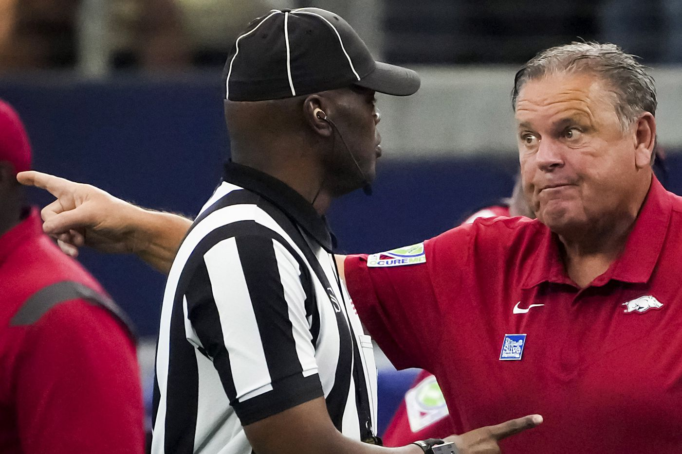 Arkansas head coach Sam Pittman argues for a call during the first half of an NCAA football game against Texas A&M at AT&T Stadium on Saturday, Sept. 25, 2021, in Arlington.