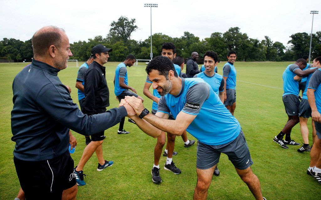 AFC soccer referee Abdulrahman Al Jassim (center) shakes hands with CONCACAF director of refereeing Brian Hall following their morning workout at Andrew Brown Park West in Coppell, Texas, Monday, June 24, 2019. The group of CONCACAF refs stay in shape and on-point as they workout between ongoing Gold Cup matches. Dallas-Fort Worth is the location of the base camp. (Tom Fox/The Dallas Morning News)