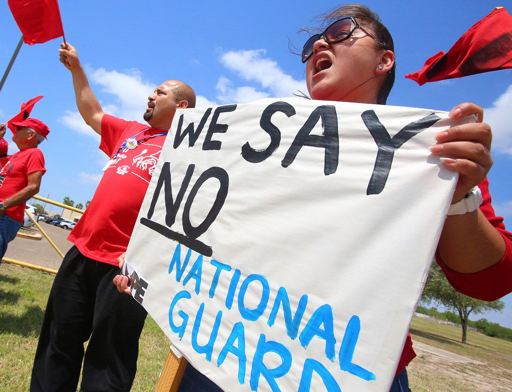 Protestors chant as Texas Gov. Greg Abbott visits the Texas National Guard Armory on Thursday, April 12, 2018, in Weslaco. Governor Abbott announced that there will be an increase of 1000 Texas National Guard on the southern border with Mexico. (Joel Martinez/The Monitor via AP)