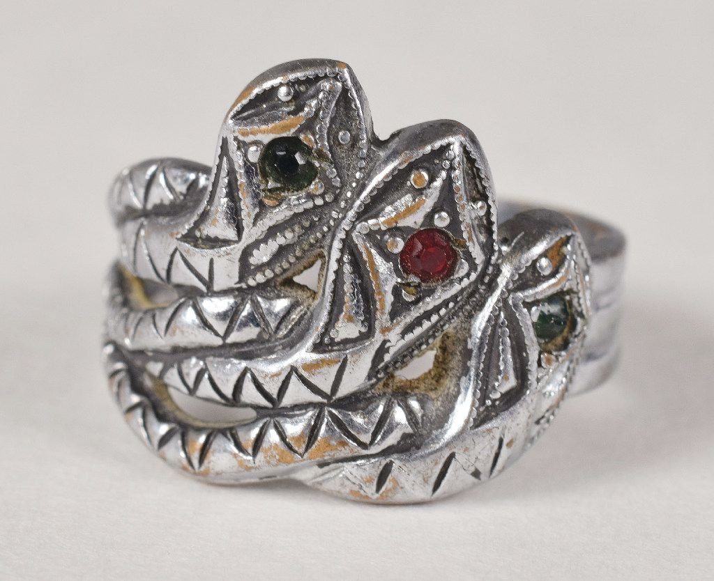Bonnie Parker's silver-toned three-headed snake ring featuring green and red jewels was sold by RR Auction. This ring is one of the jewelry and legal documents belonging or pertaining to Al Capone and Bonnie and Clyde that were auction in Boston Thursday, June 8, 2017.