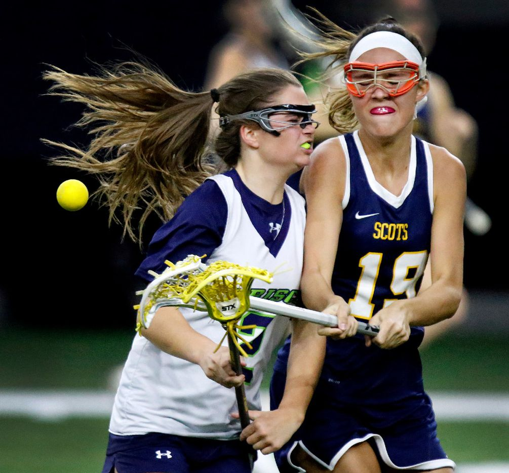Frisco's Eva Bikel (2) colides with Highland Park defender P.J. Van den Branden (19) during the second half as Highland Park played the Frisco Fury as part of the Patriot Cup lacrosse tournament at The Ford Center at The Star in Frisco on Saturday, February 18, 2017. (Stewart F. House/Special Contributor)