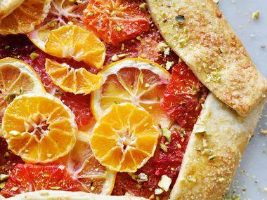 Rustic citrus galette made with pie dough, ricotta filling, blood orange, grapefruit, mandarin oranges, Meyer lemon, honey and pistachios