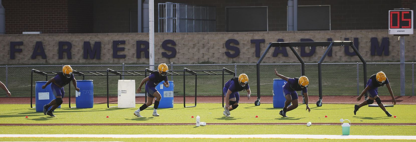 Players run through a drill during the first day of high school football practice for 4A's Farmersville High School in Farmersville, Texas on Monday, August 3, 2020. (Vernon Bryant/The Dallas Morning News)