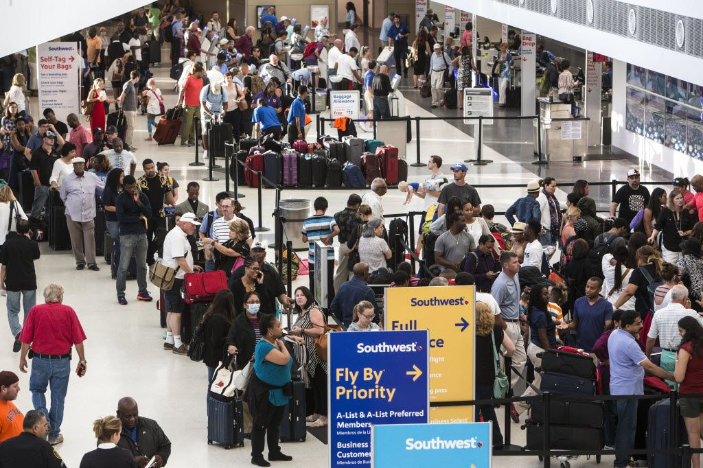 Southwest Airlines passengers stood in long lines July 21 at the ticketing/checking counter at Hobby Airport  in Houston as the airline struggled to recover from a technical outage. (Brett Coomer/Houston Chronicle via AP)