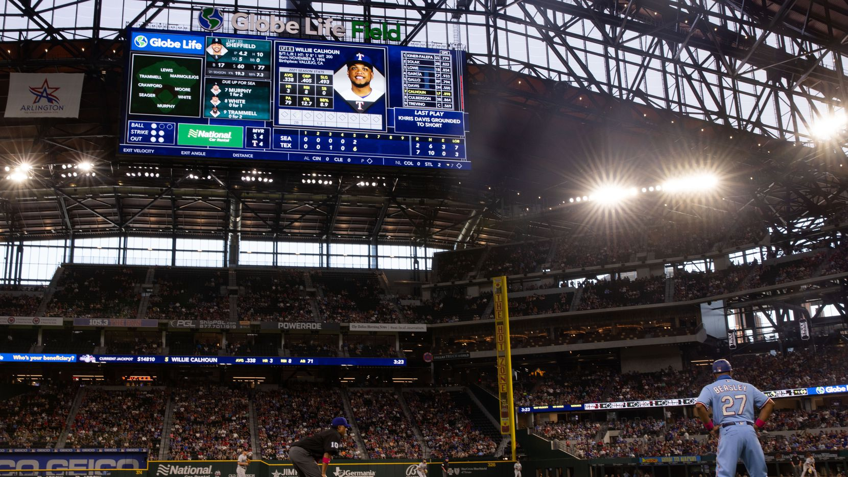 The scoreboard shows Texas Rangers left fielder Willie Calhoun (5) stats while he bats during the bottom of the fifth against the Seattle Mariners at Globe Life Field on Sunday, May 9, 2021, in Arlington.