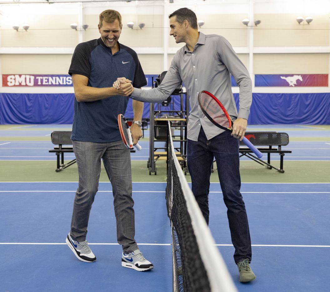 Dallas Mavericks star Dirk Nowitzki (left) shake hands after volleying the tennis ball during a press conference to announce a new ATP tennis tour event coming to Dallas at the SMU Styslinger/Altec Tennis Complex on Wednesday, May 19, 2021, in Dallas. (Juan Figueroa/The Dallas Morning News)