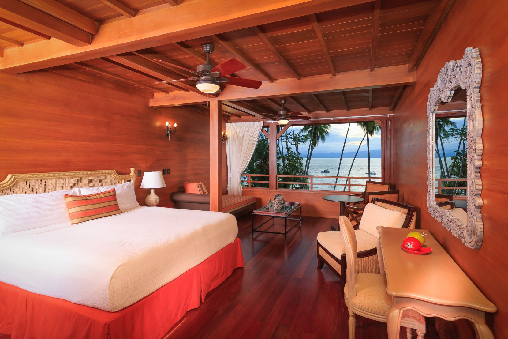 Playa Cativo Lodge offers 18 guest rooms with dark wood facades.